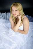 Beautiful girl in white gown — Stock Photo