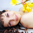 Foto Stock: Portrait beautiful girl with long hair with narcissus
