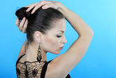 Beautiful girl brunette sits back with withdrewed hair — Stock Photo