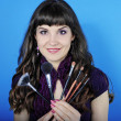 Beautiful girl visagiste with tassel for make-up with long hair - Stock Photo