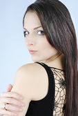 Beautiful girl brunette with long hair — Stock Photo