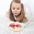 A beautiful little girl angel with a candle — Stock Photo #17416215