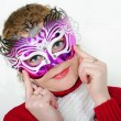 Stock Photo: Young beautiful cheerful girl in bright mask on white ba