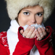 The young beautiful girl in a fur cap has control over snow — Stock Photo #17439447