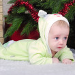 Small breast child near new year's fir tree — Foto Stock