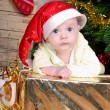 Small breast child near new year's fir tree — Stockfoto
