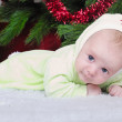 Small breast child near new year's fir tree — Lizenzfreies Foto