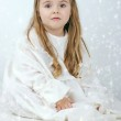 A beautiful little girl angel with a candle — Stock Photo