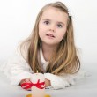 A beautiful little girl angel with a candle — Stock Photo #17837289
