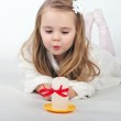 A beautiful little girl angel with a candle — Stock Photo #17837439