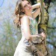 Beautiful girl in green wood by summer - Stock Photo