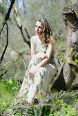 Beautiful girl in green wood by summer — Stock Photo