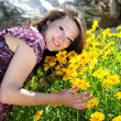 Beautiful pregnant girl with flowers — Stock Photo