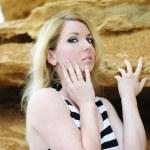 Portrait of the beautiful blonde near clay captive — Stock Photo
