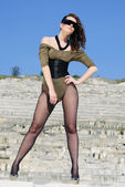 Beautiful girl on heel amongst stone captive — Stock Photo
