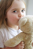 Beautiful little girl with a favorite toy — Stock Photo