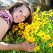 Beautiful pregnant girl with flowers — Stock Photo #24359229