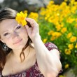 Beautiful girl in yellow flowers — Foto Stock #24359259