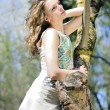 Beautiful girl in green wood by summer — Stock Photo #24793611