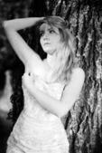 Beautiful girl bride in green wood by summer — Стоковое фото