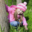 Stock Photo: Beautiful little girl near flowering tree
