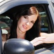 A pretty girl driving a car — Stock Photo #26246397