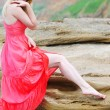Beautiful blonde ashore epidemic deathes in rose gown — Stock Photo #26246785