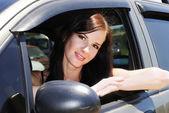 A pretty girl driving a car — Stock Photo