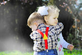 Couple in love little kids for a walk in the park — Stock Photo