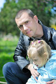 Little girl in the spring in the park for a walk with his father — Stock Photo