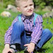Little boy on a green meadow — Stock Photo #30026923