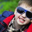 Smiling little boy with glasses — Stock Photo #30026997