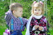 Couple in love little children on green meadow — Stock Photo