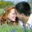 Beautiful young couple in love on a green glade — Stock Photo