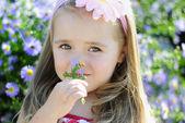 Pretty little girl near colors — Stock Photo