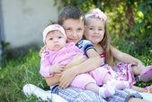 Three kids near colors — Stock Photo