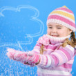 The little girl in a sweater and a hat with the snow — Foto de Stock