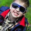 Smiling little boy with glasses — Stock Photo