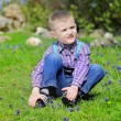 Little boy on a green meadow — Stock Photo