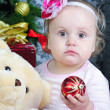 Small girl near new year's fir tree — Stock Photo
