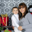 Small boy with ma near new year's fir tree — Stock Photo