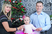 Small girl with parent near fir trees — Stock Photo