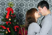 Young couple in love near new year's fir tree — Stock Photo