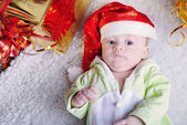 Small breast child near new year's fir tree with gift — Stock Photo