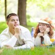 Young beautiful couple on green grass in autumn — Foto Stock