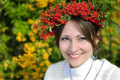Beautiful girl with a wreath on his head fall — Stock Photo