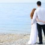 Beautiful young couple in love near the sea — Stock Photo #37277337