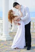 Beautiful young couple in love near the sea — Stock Photo