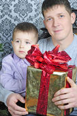 Father with child near beautiful new year's fir tree — Stock Photo