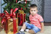 Small boy near new year's fir tree — Stock Photo